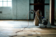 Interior Of An Abandoned Warehouse With A Parquet Sanding Machine