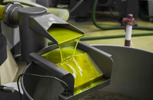 Closeup Shot Of An Olive Oil Extraction Process In A Factory