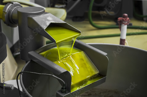 Canvas Print Closeup shot of an olive oil extraction process in a factory