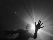 Back Lit Of Silhouette Man Swimming Undersea