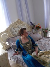 Young Woman Leaning On Bed At Home