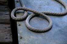 Close-up Of Rope On Metal By Pier