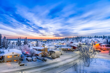 Sunrise Over Looking Neighborhood In Yellowknife During Winter With Snow, Road And Clouds