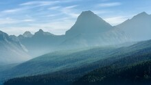 The Early Morming Mist Rolls Through The Mountains At Lake McDonald In Glacier National Park, Montana, USA
