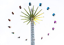 Low Angle View Of Amusement Park Ride Against Clear Sky