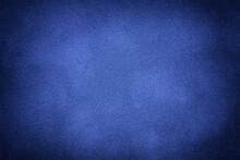 Blue Matte Background Of Suede Fabric With Vignette, Closeup. Velvet Textile.