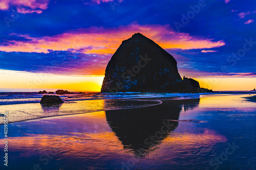 Fotografie, Obraz Colorful Sunset Haystack Rock Reflection Canon Beach Oregon