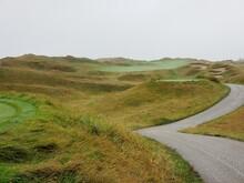 Golf Cart Path Along Links Style Hole On Misty Day