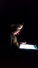 Close-up Of Baby Boy Using Digital Tablet