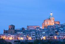 Illuminated Cityscape Against Clear Blue Sky