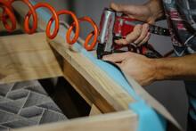 Closeup Shot Of A Male Working In A Furniture Factory