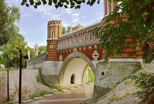The Figure Bridge In Tsaritsyno. Decorative Bridge In The Palace And Park Ensemble Of The XVIII Century, Architect Vasily Bazhenov. Red Brick, Stone Arch, Gothic Stylization