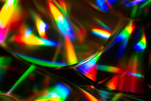 Macro Shot Of CDs With Colorful Reflections