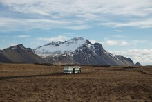 Isolated Idyllic Abandoned School Bus Parked In Meadow Grass Field Nature Landscape Near Hofn I Hornafirdi Iceland