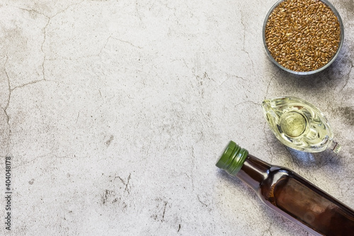 Fotografie, Obraz Linseed oil in a bottle, flax seeds, salad dressing in a gravy boat source of om