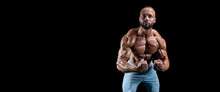 Isolated Muscular Man On A Black Background. Bodybuilding And Fitness Concept. Panorama.