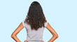 Leinwandbild Motiv Young african american girl wearing casual clothes standing backwards looking away with arms on body