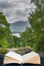 Digital Composite Of Stunning Long Exposure Landscape Image Of Ashness Bridge In English Lake District During Late Summer Afternoon With Dramatic Lighting In Pages Of Open Book