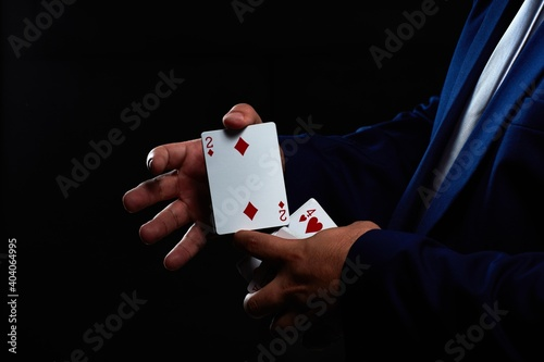Magician illusionist showing performing card trick Wallpaper Mural