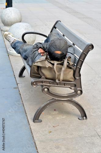 Carta da parati Full Length Of Man Lying On Bench At Sidewalk