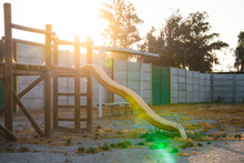 Small Park With Playgrounds Abandoned By The Pandemic, In A Sunset