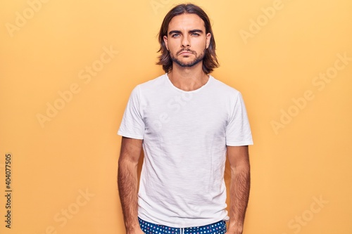 Fotografie, Obraz Young handsome man wearing casual clothes skeptic and nervous, frowning upset because of problem
