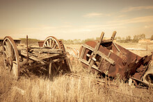 Old Rusty Vintage Farm Equipment - Old Chariot And An Old Hay Baler