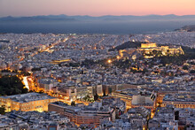 View Of The City Of Athens, During Sunset. On The Right There Can Be Seen Acropolis And The Parthenon, And On Bottom Left The Greek Parliament.