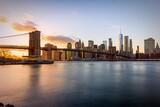 Fototapeta Kuchnia - View Of Suspension Bridge In City At Sunset