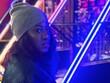 Leinwandbild Motiv Close-up Portrait Of Young Woman Against Illuminated Lights