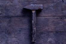 An Old Hammer On Old Wooden Desk