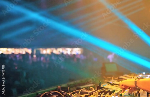 Obraz Cropped Hand Of Person Operating Musical Instrument At Nightclub - fototapety do salonu