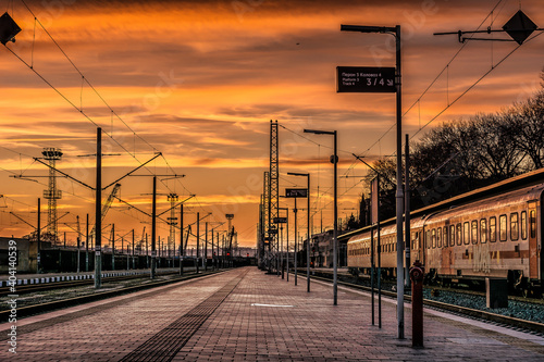 Railroad Station Platform Against Sky During Sunset