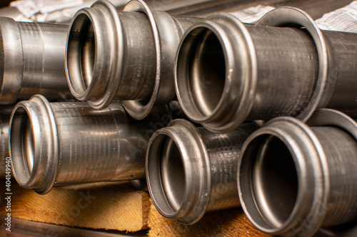 Fotografering Metal pipes for the automotive industry are stored in a warehouse on a rack