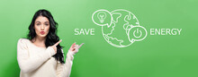 Save Energy Concept With Young Woman Pointing On A Green Background