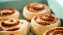 Unbaked Cinnamon Rolls In A Blue Baking Pan.