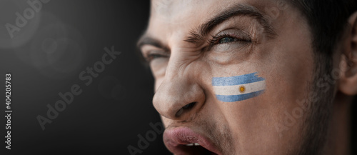 Cuadros en Lienzo A screaming man with the image of the Argentina national flag on his face
