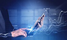 Woman With Tablet In Office And Graphs