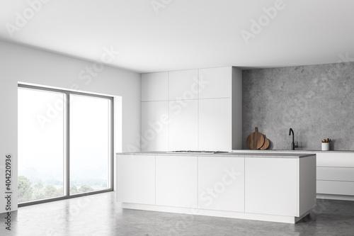 Obraz White and concrete kitchen corner with island and window - fototapety do salonu