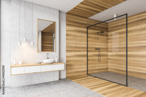Wooden and white bathroom with shower, sink and mirror