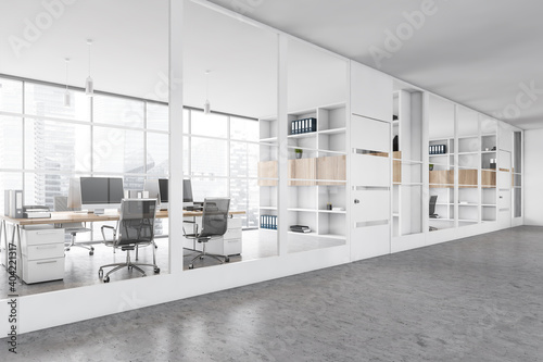 White office room with chairs and table behind glass windows