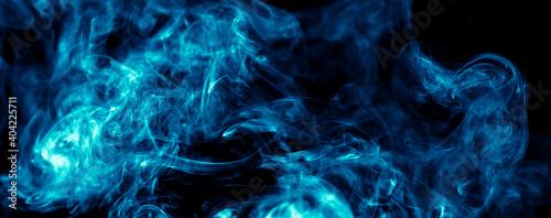 Foto Blue smoke isolated on black background.