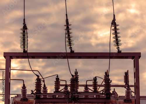 Fototapeta Electrical substation with wires at dawn.