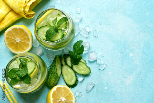 Delicious cold summer lemonade with cucumber and mint. Top view with copy space.
