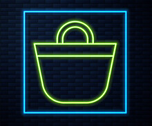 Glowing Neon Line Beach Bag Icon Isolated On Brick Wall Background. Vector.