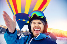 Selfie Photo Is Made By Man Skier On Background Of Colored Balloon In Winter