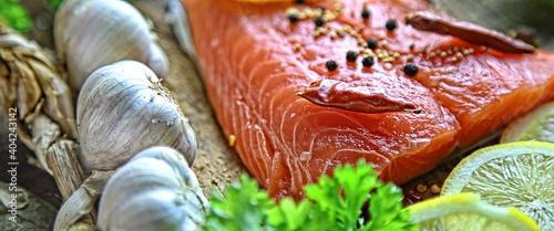 healthy delicious salmon with salt, lemon and salad