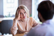 Young Caucasian Woman Disinterested In Blind Date, Feeling Bored With Conversation At City Cafe
