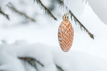 Pine Cone Christmas Ball Hanging On Pine Branches Covered With Snow In A Snowy Forest