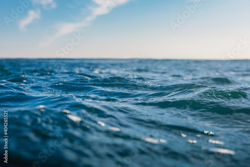 Blue waves in sea. Water texture with bokeh